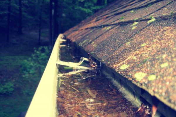 clogged gutters damage homes